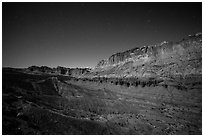 Fluted cliffs of Waterpocket Fold at night. Capitol Reef National Park, Utah, USA. (black and white)