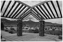 Courtyard, sign and mountains, Great Basin Visitor Center. Great Basin National Park ( black and white)