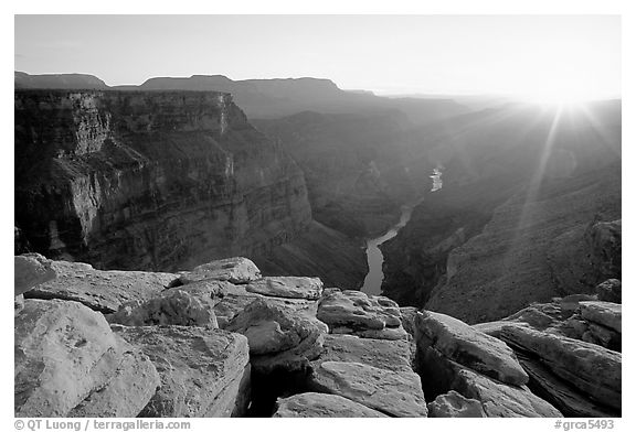 Cracked rocks and Colorado River at Toroweap, sunset. Grand Canyon National Park (black and white)