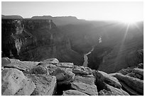 Cracked rocks and Colorado River at Toroweap, sunset. Grand Canyon National Park, Arizona, USA. (black and white)