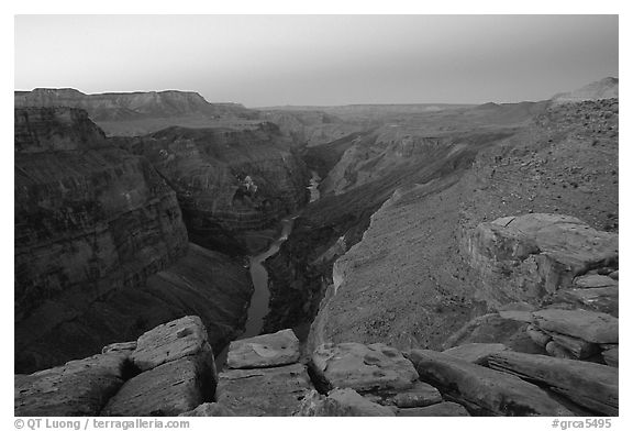 Cracked rocks and Colorado River at Toroweap, dawn. Grand Canyon National Park (black and white)