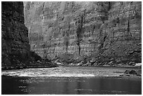 Glassy river and rapids below Redwall limestone canyon walls. Grand Canyon National Park ( black and white)