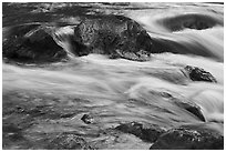 Boulders and rapids with glow from canyon walls reflected. Grand Canyon National Park ( black and white)