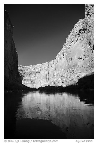 Steep limestone canyon walls reflected in Colorado River, early morning. Grand Canyon National Park (black and white)