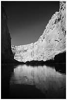 Steep limestone canyon walls reflected in Colorado River, early morning. Grand Canyon National Park ( black and white)