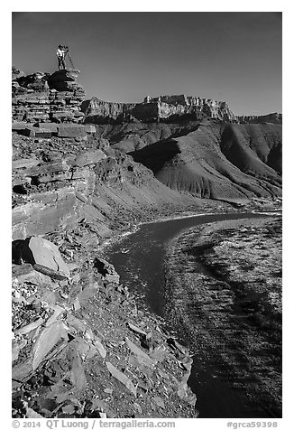 Photographer on sheer cliff above Unkar rapids. Grand Canyon National Park (black and white)
