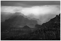 Canyon ridges with dramatic clouds and sunrays. Grand Canyon National Park ( black and white)