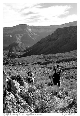 Backpackers in Surprise Valley, Thunder River and Deer Creek trail. Grand Canyon National Park (black and white)