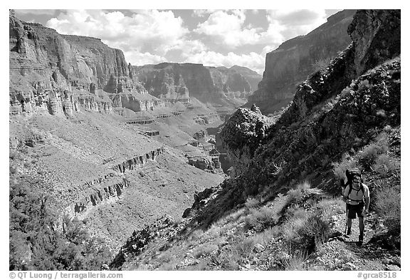 Backpacker on trail above Tapeats Creek. Grand Canyon National Park (black and white)