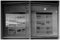 Sunset and attractions listings, Far View visitor center window reflexion. Mesa Verde National Park, Colorado, USA. (black and white)