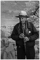 Native American Ranger plays flute to honor ancestors. Mesa Verde National Park ( black and white)