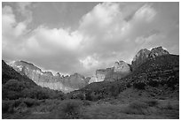 Wide view of Towers of the Virgin and clouds at sunrise. Zion National Park, Utah, USA. (black and white)