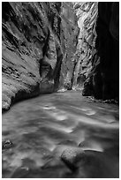 River flows beneath soaring sandstone walls, the Narrows. Zion National Park ( black and white)