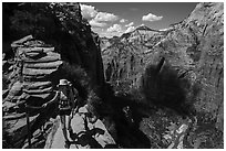 Hiker holds onto chain, Angels Landing. Zion National Park ( black and white)