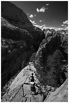 Hikers using chains and steps to descend Angels Landing. Zion National Park ( black and white)