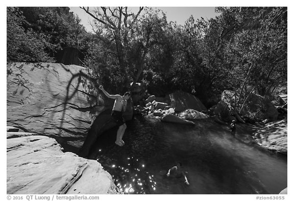 Man jumping into water, Pine Creek. Zion National Park (black and white)