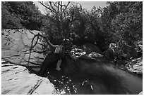 Man jumping into water, Pine Creek. Zion National Park ( black and white)