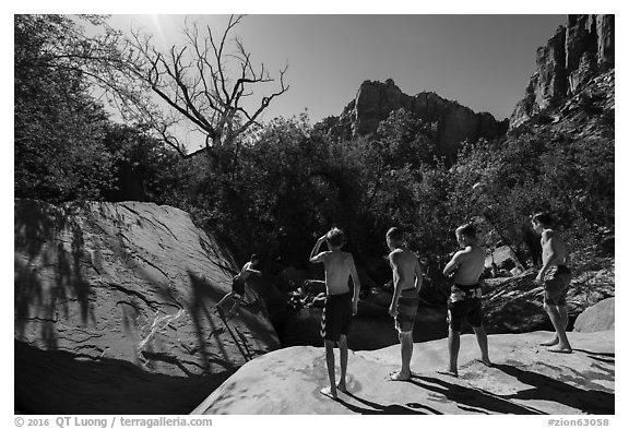 Children on rock above swimming hole, Pine Creek. Zion National Park (black and white)