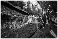 Waterfall over red travertine in the spring. Zion National Park ( black and white)