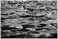 Badland ridges and prairie from above, sunrise. Badlands National Park, South Dakota, USA. (black and white)