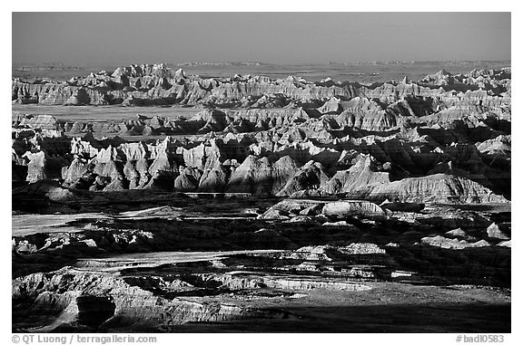 View over eroded ridges from Pinacles overlook, sunrise. Badlands National Park (black and white)