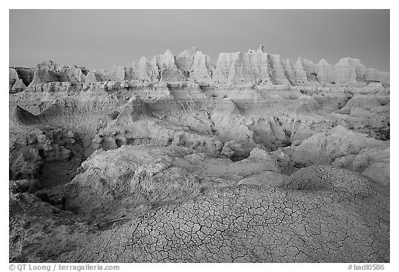 Cracked mud and erosion formations, Cedar Pass, dawn. Badlands National Park (black and white)