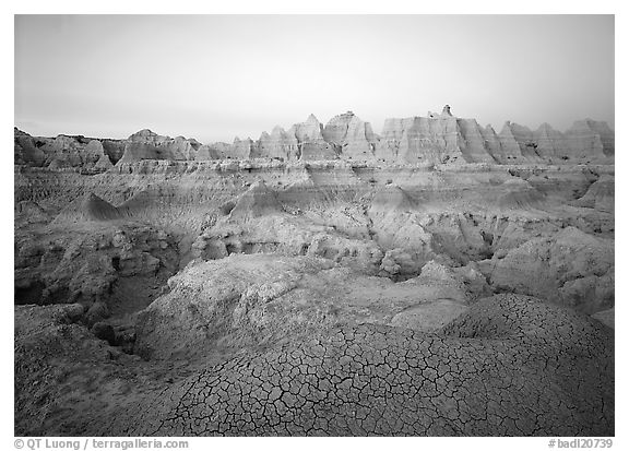 Cracked mudstone and eroded towers near Cedar Pass, dawn. Badlands National Park (black and white)