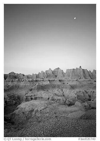 Mud cracks, badlands, and moon at dawn. Badlands National Park (black and white)