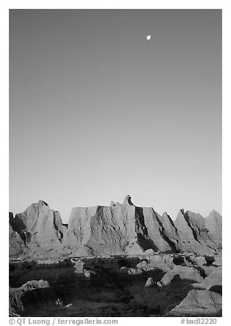 Moon and erosion formations, Cedar Pass, dawn. Badlands National Park (black and white)