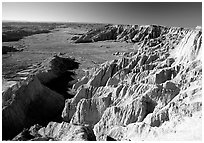Prairie between badlands at Burns Basin overlook. Badlands National Park, South Dakota, USA. (black and white)