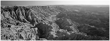 Badlands carved into prairie by erosion, Stronghold Unit. Badlands National Park (Panoramic black and white)