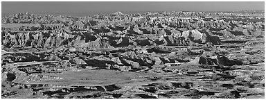 Prairie mixed with badland ridges. Badlands National Park (Panoramic black and white)