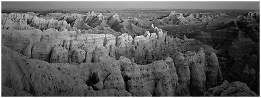 Eroded badland scenery at dusk, Stronghold Unit. Badlands National Park (Panoramic black and white)