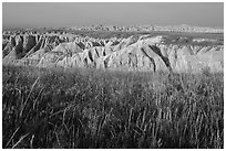 Mixed grass prairie alternating with badlands. Badlands National Park, South Dakota, USA. (black and white)