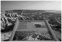 Interpretative sign, Sage Creek badlands. Badlands National Park, South Dakota, USA. (black and white)