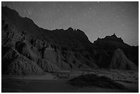 Badlands and star trails. Badlands National Park, South Dakota, USA. (black and white)