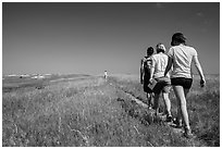 Hikers on Medicine Root Trail. Badlands National Park, South Dakota, USA. (black and white)