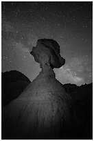 Balanced rock at night with starry sky and Milky Way. Badlands National Park, South Dakota, USA. (black and white)
