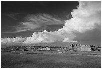 Afternoon clouds above buttes and prairie, South Unit. Badlands National Park, South Dakota, USA. (black and white)