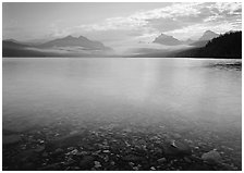 Lake McDonald with clouds and mountains reflected in early morning. Glacier National Park, Montana, USA. (black and white)
