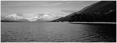 Snowy mountains across Mc Donald Lake. Glacier National Park (Panoramic black and white)