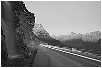 Roadside waterfall and light trail, Going-to-the-Sun road. Glacier National Park ( black and white)