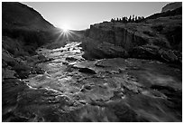 Outlet stream of Swiftcurrent Lake, sunrise. Glacier National Park, Montana, USA. (black and white)