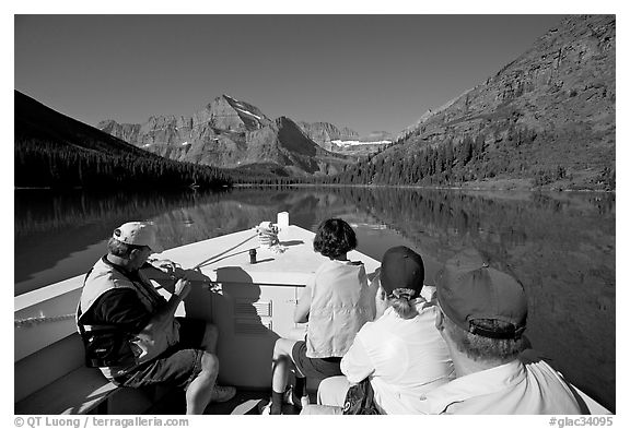 Riding the tour boat on Lake Josephine. Glacier National Park (black and white)