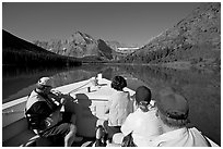 Riding the tour boat on Lake Josephine. Glacier National Park, Montana, USA. (black and white)