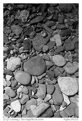 Colorful pebbles and shadow. Glacier National Park (black and white)