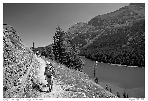 Hikers on trail above Lake Josephine. Glacier National Park (black and white)