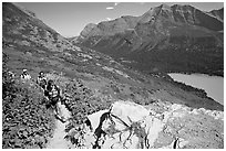 Women hiking on the Grinnell Glacier trail. Glacier National Park, Montana, USA. (black and white)
