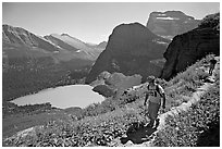 Hikers on trail overlooking Grinnell Lake. Glacier National Park, Montana, USA. (black and white)