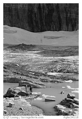 Crossing the outlet stream of the Grinnell glacial lake. Glacier National Park (black and white)
